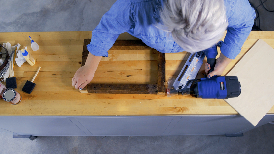 join edges of barn wood tray with nail gun