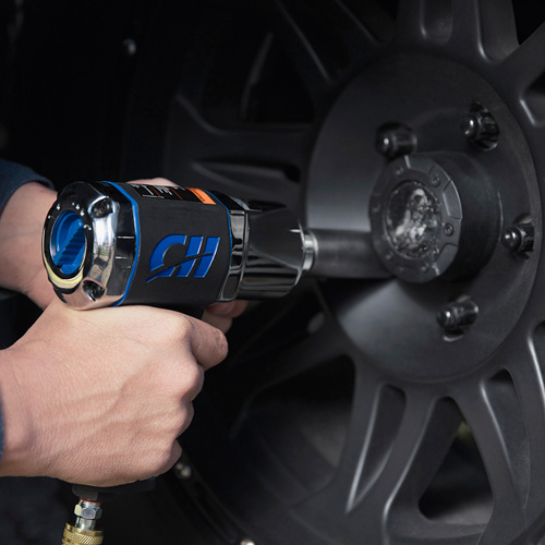 Man using Campbell Hausfeld 1/2-Inch Impact Wrench on hub caps